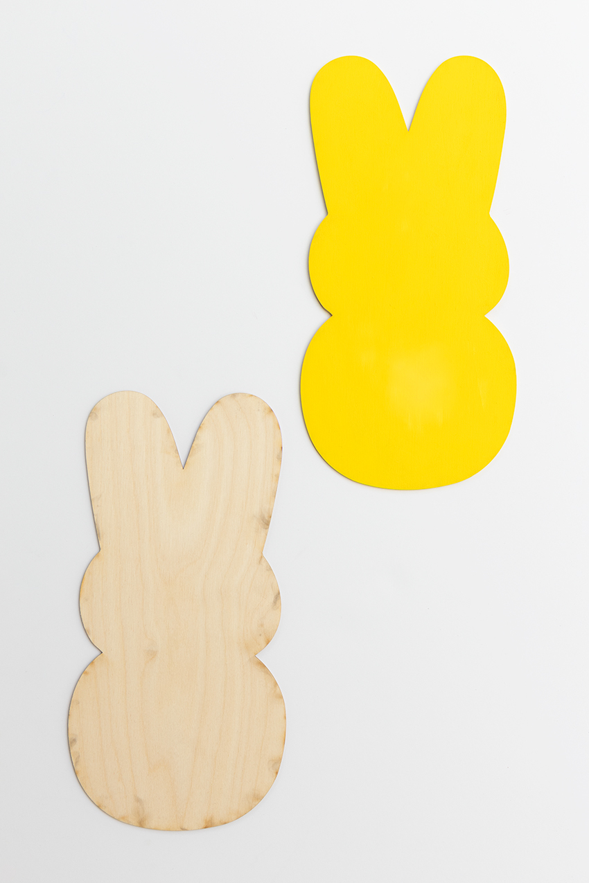 Painting a wooden peep.